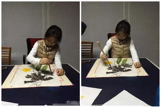王菲和李亚鹏小女儿正在画画