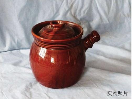 带手柄的陶罐照片